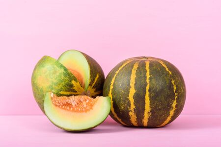 Thai Melon on pink background, tropical fruit