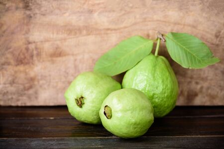 Fresh guava fruit on wooden background, healthy fruit