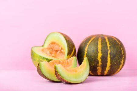 Thai melon fruit on pink background 版權商用圖片