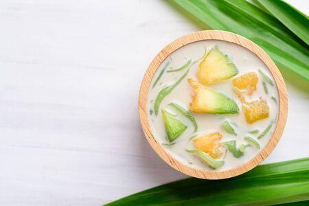Thai dessert (Lod Chong), rice flour pandan flavor and sliced melon fruit in coconut milk Stock Photo - 135372350