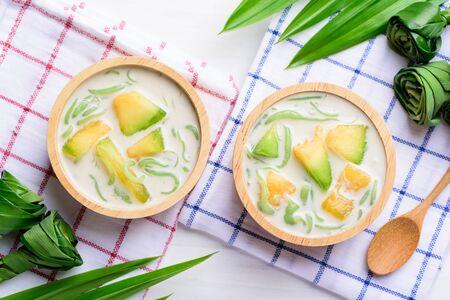 Thai dessert (Lod Chong), rice flour pandan flavor and sliced melon fruit in coconut milk