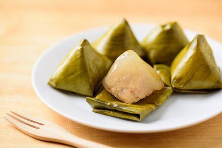 Thai dessert (Khanom Tian), sweet stuffed dough pyramid wrapped by banana leaf