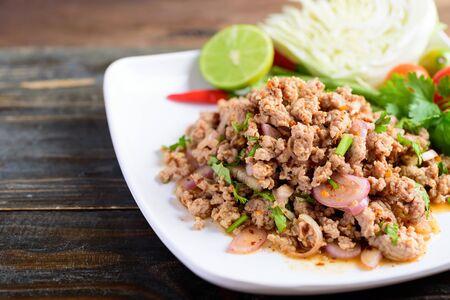 Thai food, spicy minced pork salad (Larb Moo) on white dish Banco de Imagens