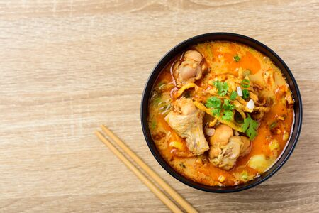 Traditional Northern Thai food (Khao Soi), spicy curry noodles soup with coconut milk and chicken