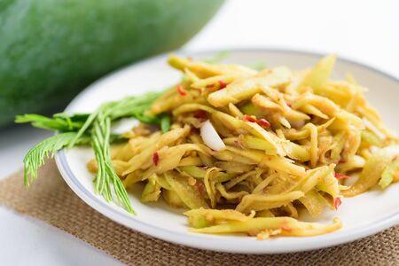 Spicy green mango salad, Thai food (Tum Ma Muang)