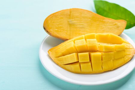 Ripe mango fruit sliced to cubes on white plate ready to eating, tropical fruit, Thai mango (Nam Dok Mai)