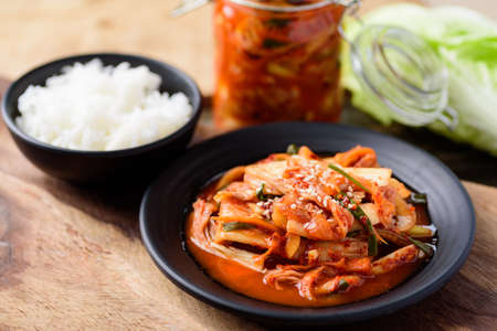 Kimchi cabbage on plate eating with cooked rice, Korean food