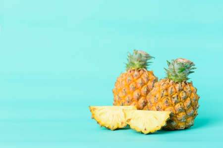 Pineapple fruit on pastel green background, Tropical fruit