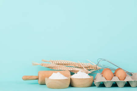 Kitchen utensils and food ingredients for bakery cooking on color background