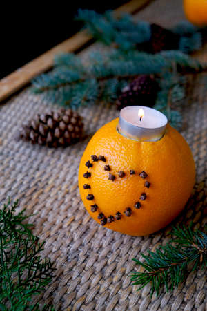 Craft from an orange. Handwork. Christmas decor with orange. Christmas table setting with holiday decorations. New year food holiday, holiday, food art concept