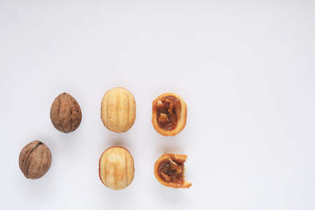 Creative mockup of walnut cookies and walnuts. Food concept. Cookies on a white background.