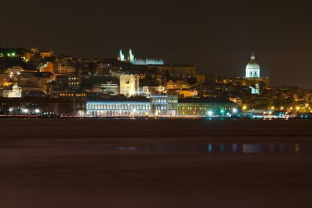 The tagus river is like a mirror reflecting the downtown of Lisbon photo