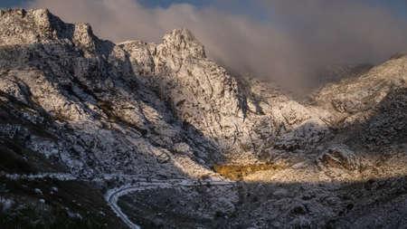 Serra da Estrela, Portugal. Perhaps the most impressive mountain landscape in Portugal. in the heart of the Serra da Estrela natural park, the Cantaro raso and Cantaro Magro peaks embrace the small forest of covao d´ametade. Stock fotó