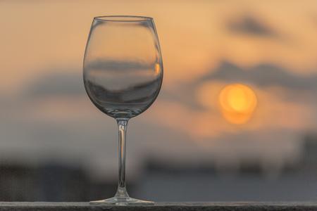 empty wine glass in sunset Stock Photo