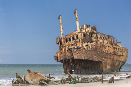 ship cemetery - abandoned ship carcass in the atlantic ocean, Angola, Africa Foto de archivo - 104037721
