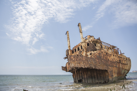 ship cemetery - abandoned ship carcass in the atlantic ocean, Angola, Africa