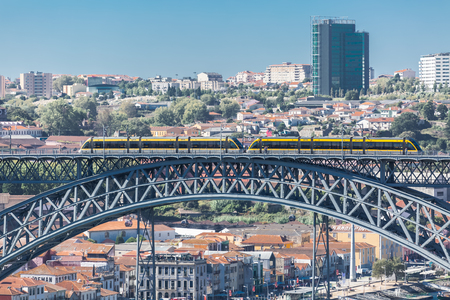 Porto/Portugal - 10/02/2018 : View of D. Luis bridge, with two subways to cross at the top, Douro river with boats and Vila Nova de Gaia city as background