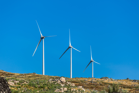 View of a wind turbines on top of mountains, in Portugal...
