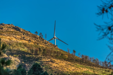 View of a wind turbine on top of mountains, in Portugal...