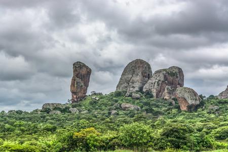 View at the mountains Pungo Andongo, Pedras Negras (black stones), huge geologic rock elements, in Malange, Angola Banco de Imagens - 117139019