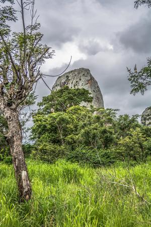 View at the mountains Pungo Andongo, Pedras Negras (black stones), huge geologic rock elements, in Malange, Angola Banco de Imagens - 117139022