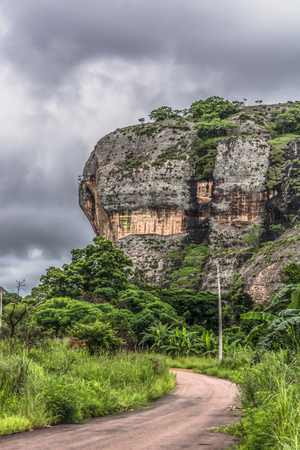 View at the mountains Pungo Andongo, Pedras Negras (black stones), huge geologic rock elements, road and power lines, in Malange, Angola Imagens