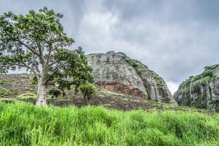 View at the mountains Pungo Andongo, Pedras Negras (black stones), huge geologic rock elements, in Malange, Angola Banco de Imagens - 117139052