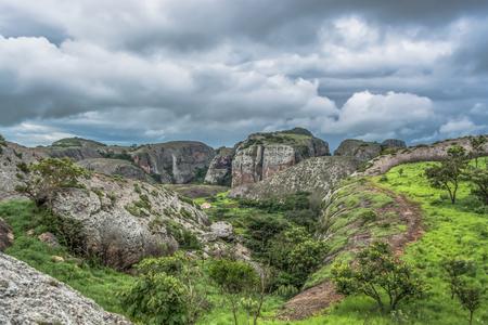 View at the mountains Pungo Andongo, Pedras Negras (black stones), huge geologic rock elements, in Malange, Angola Banco de Imagens - 117139053