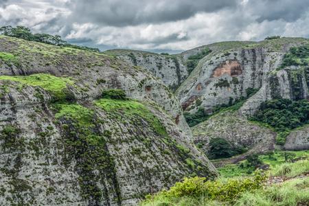 View at the mountains Pungo Andongo, Pedras Negras (black stones), huge geologic rock elements, in Malange, Angola Banco de Imagens - 117139054