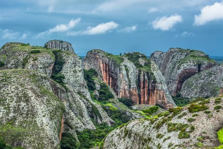 View at the mountains Pungo Andongo, Pedras Negras (black stones), huge geologic rock elements, in Malange, Angola Banco de Imagens - 117139056