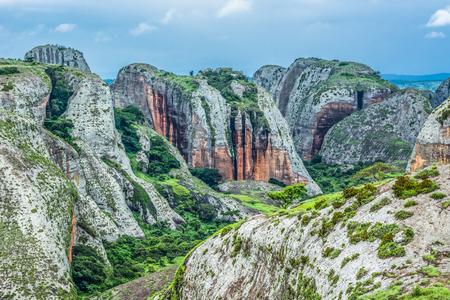 View at the mountains Pungo Andongo, Pedras Negras (black stones), huge geologic rock elements, in Malange, Angola Banco de Imagens - 117139058