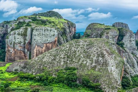 View at the mountains Pungo Andongo, Pedras Negras (black stones), huge geologic rock elements, in Malange, Angola Banco de Imagens - 117139064