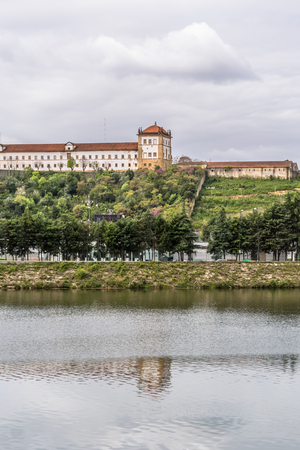 View of part of the Confraternity building of the Queen Santa Isabel, view of the Mondego river in Coimbra, Portugal