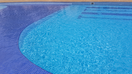 View at a transparent water pool and blue background with dark blue stripes...