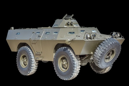 Front view of old armored military vehicle, black background