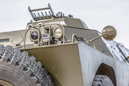 Detailed front view of old armored military vehicle, white background