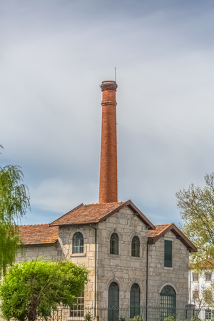 Viseu  Portugal - 04 16 2019 : View of the Museum of electricity, top building with chimney in industrial brick, in the enclosure of the market of São Mateus in Viseu