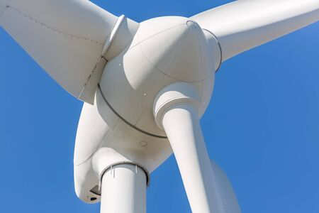 Detailed close up view of a wind turbine; generator, rotor and blade view