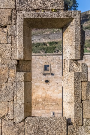 Tarouca  Portugal - 03 15 2018: View of historic building in ruins, convent of St. Joao of Tarouca, detail of ruined wall with hole door, and blurred background
