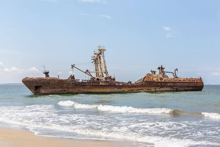 View of a abandoned ships carcasses in the ships cemetery, graveyard ships on the atlantic ocean, Angola, Africa Stock Photo