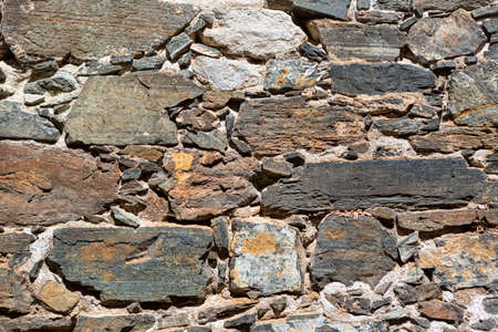 Architecture textures, detailed rusty and rustic old wall masonry schist...