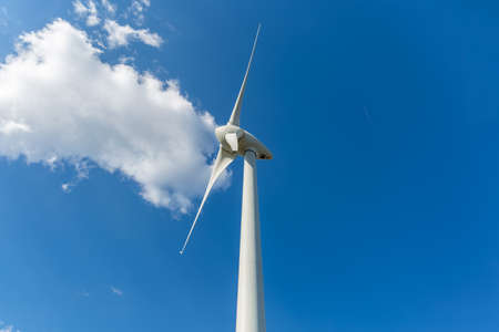 Detailed close up view of a wind turbine; generator, rotor and blade view...