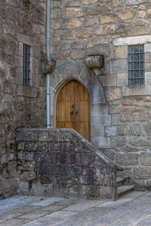 View at the back entrance door in Palace of the Dukes of Braganca facade, medieval estate and former residence in Guimaraes city