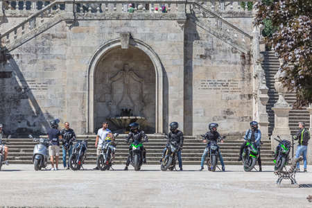 Lamego / Portugal - 07 25 2019 : View at the staircase entrance with a group of bikers and motorcycles, Lamego Cathedral with a huge stairway