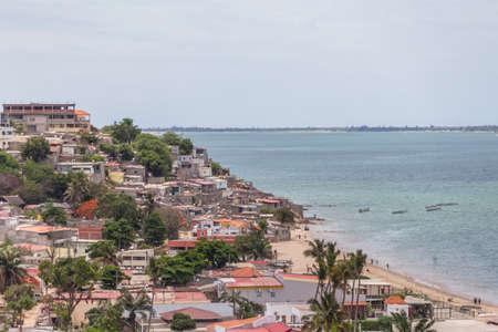 Luanda / Angola - 12/07/2020: Beach view with fishermen and traditional Angolan boats, ghetto neighborhood on the sea coast in Luanda beach, Mussulo Island as background