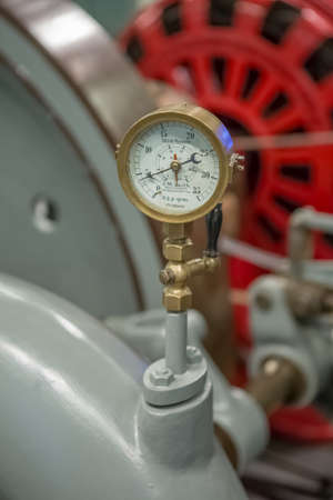 Seia / Portugal - 08 22 2020: Detailed view of old barometer of power hydroelectric generator engine...