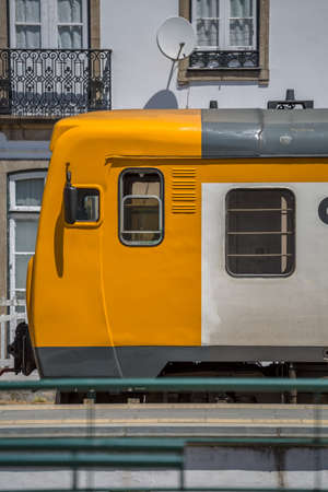 Front view of a regional train, typical of the Portuguese train network, at the train station in the city of Peso da Regua...