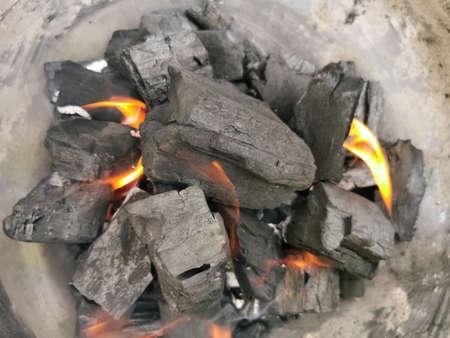 Macro view of burning coal embers bonfire, detail of coal texture...