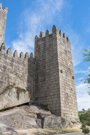 Guimaraes / Portugal 09 12 2020: Back facade view at the Castle of Guimaraes, a iconic medieval castle, in the northern region of Portugal 新闻类图片