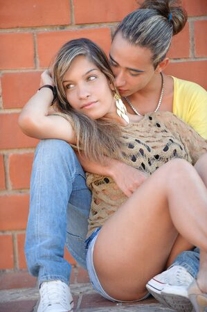 Couple in love embraced in tender position photo